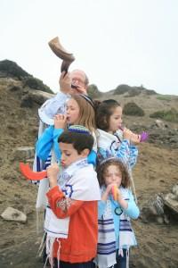 Blowing the shofar by the beach