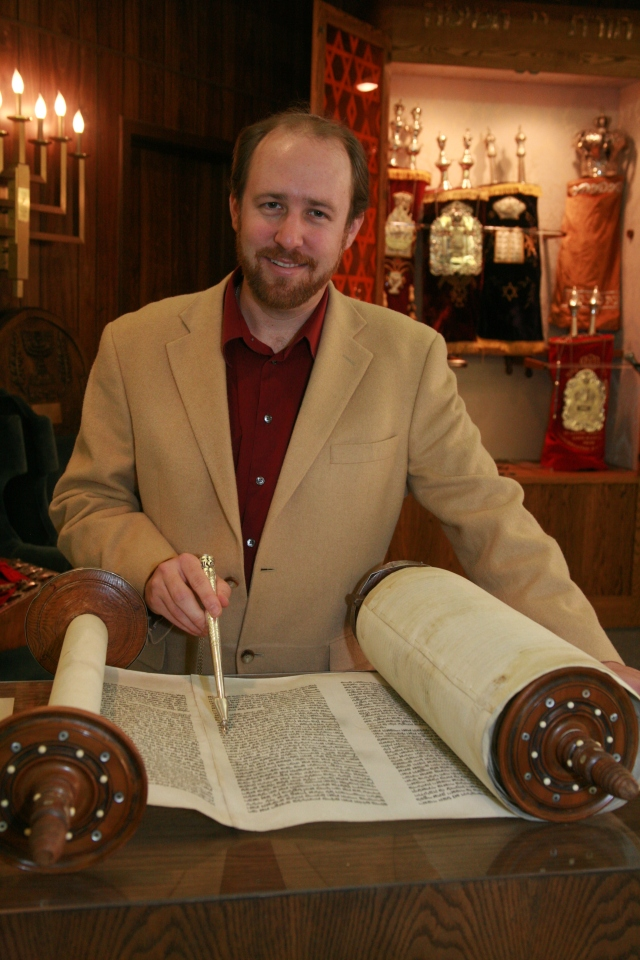 Shais St.Martin at the Torah scroll.