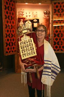 Linda Wertheim in front of the open ark.
