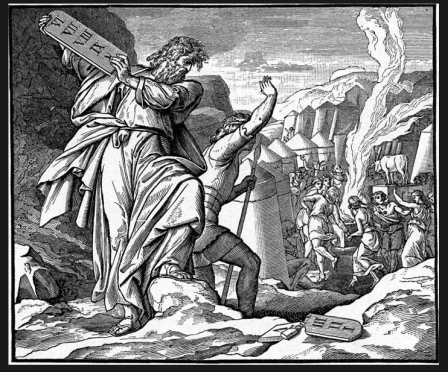 Moses breaks the stone tablets.