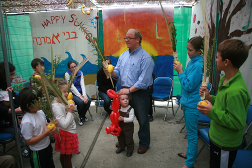 Sukkot celebration at B'nai Emunah with Rabbi Mark Melamut. Photograph by Gabriele Lange, 2012