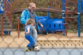 Rabbi Mark Melamut and his son Geffen play soccer on the blacktop before the schoolday begins at Brandeis Hillel Day School on May 20, 2015. (Photo by Drake Newkirk)