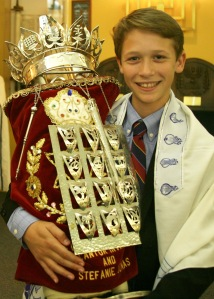 Joshua holding Torah scroll for the first time